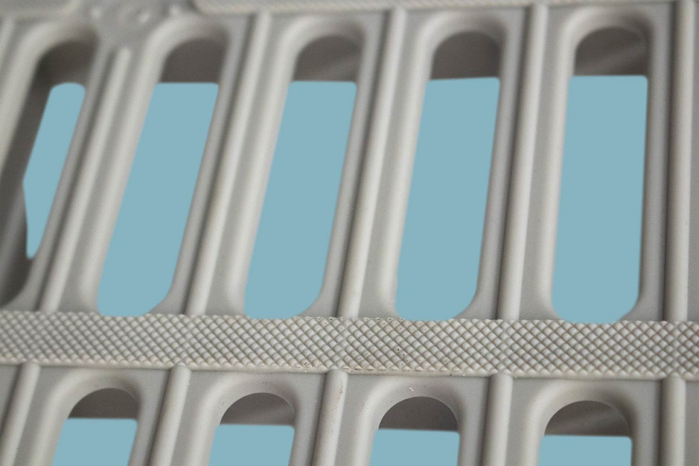A close up of the spaces in an Aqua-Dek dock panel.